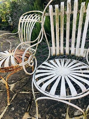 A near matching pair of antique French, ornate garden chairs with sprung seats