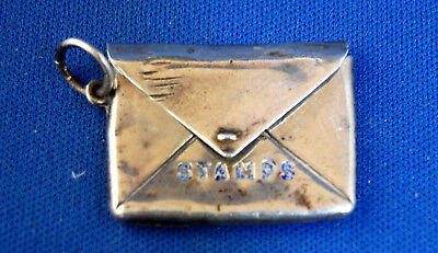 A nice antique Edwardian silver envelope stamp case with hanging ring