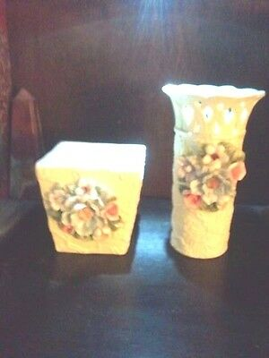 White vases with  flowers, Set of two, one tall and flared at top, other shorter