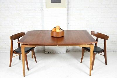Mid century modern kitchen dining table with sculptural legs and rosewood detail