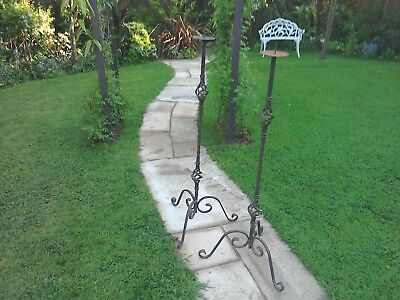 Antique/Vintage wrought iron large floor standing candlesticks.