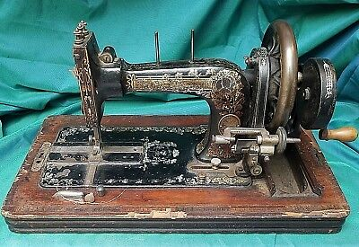 1907 Frister & Rossman hand-crank sewing machine, inlaid case, oak leaves decals