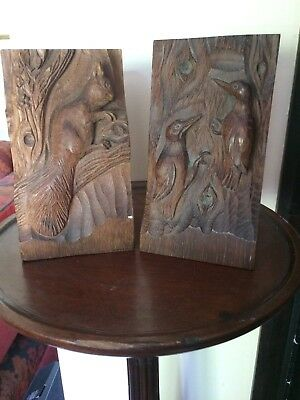 Arts & Crafts carved wooden book ends depicting squirrel and woodpeckers