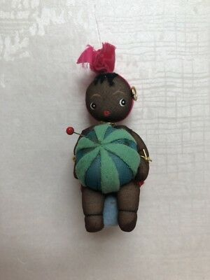 Vintage pin cushion and tape measure doll