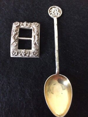 Oriental Silver Buckle With A Chinese Spoon
