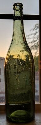 Very nice old light green bottle - bubbles !