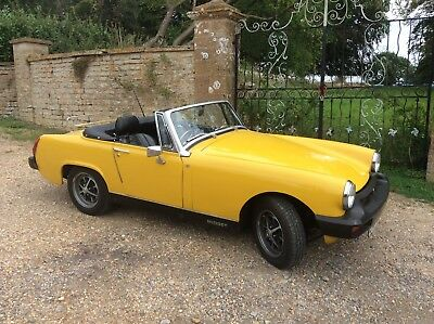 MG Midget 1979 in Inca yellow.