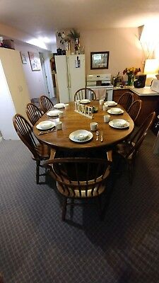 8 person solid oak dining table with 2 extra leaves