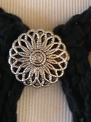 The mattie silver tone flower sweater clip brooch