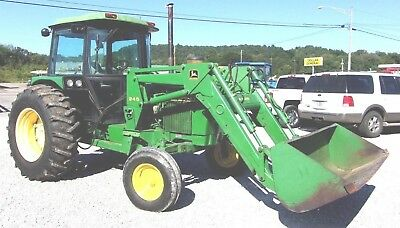 John Deere 2750 Tractor 3036 Hrs with Loader. Ships @ $1.85 per loaded mile.