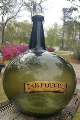 Large colonial blackglass globular apothecary bottle. PONTILED