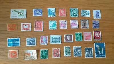 Bundle of 31 assorted old/vintage postage stamps from around the world. Used.