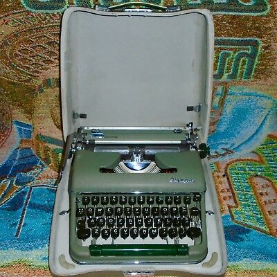 Vintage Rare Green Olympia SM4 Cursive Font Typewriter with Case - Works Great