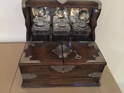 Antique 19thC English Tiger Oak wood Tantalus with 3 decanters + extras.