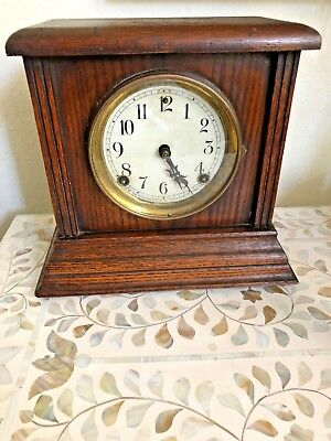 Antique American chiming cabinet mantle clock