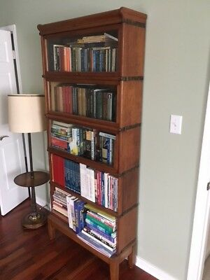 Gorgeous 5 tier Walnut Lawyers Bookcase in excellent condition.