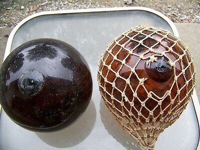 """Swedish L Marked Float Dark Reddish Brown 6"""" the float pictured on the left."""