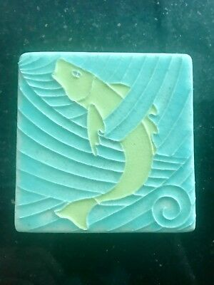 "Motawi Tileworks, Ann Arbor, 4"" yellow Fish Tile, surf green background"