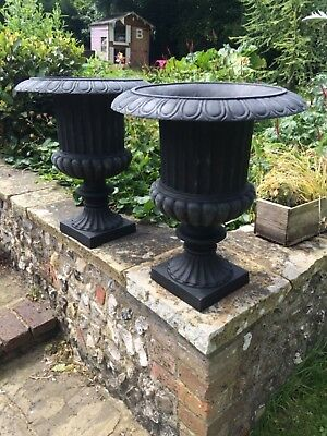 "An impressive pair of cast iron, Victorian style matching urns, 20"" tall"