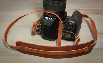 42in Hand made leather copper riveted camera strap with moveable shoulder pad.