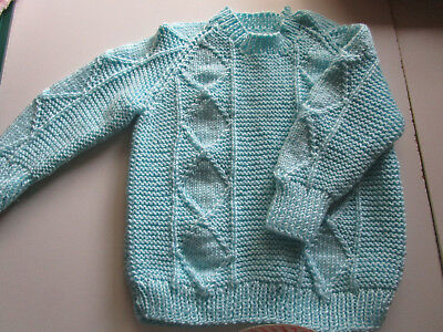 babies hand knitted jumper