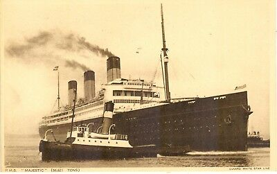 White Star Line's MAJESTIC of 1922 under tow  (ex-Hapag BISMARK of 1914)