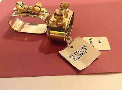 Two New Metal Napkin Rings - oblong, silver with gold bows