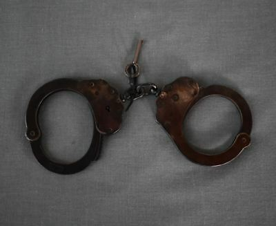 Vintage Black Jay-Pee handcuffs with key