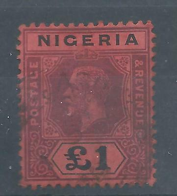 Nigeria 12 U F-VF one pounder of King George V with a SCV $ 235.00