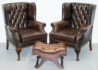 Pair Of 1960's Aged Brown Leather Chesterfield Wingback Armchairs & Footstool
