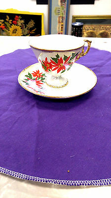 Christmas Coffee cup and matching saucer with a poinsettia flower lefton