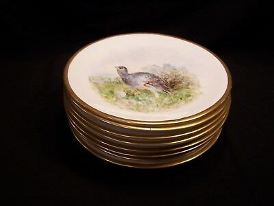 Set of 8 Antique gold rimed plates with beautiful handpainted birds