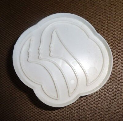 """This white plastic Trefoil Girl Scout Cookie Cutter is 3"""" wide, 2.75"""" high"""