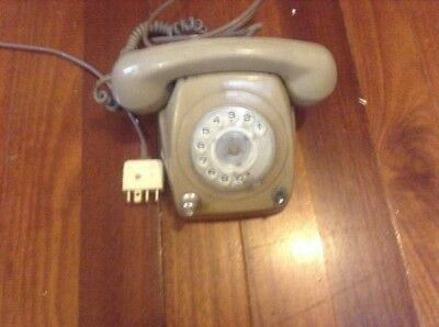 Old plastic rotary phone with volume control plus cut off switch