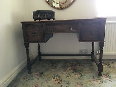 Antique oak desk with brass handles and worn leather top, c. 1880s