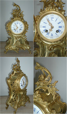 Antique french bronze clock in style Louis XV.