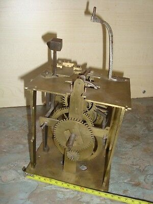 Brass clock movement with striking / Hammer Action.