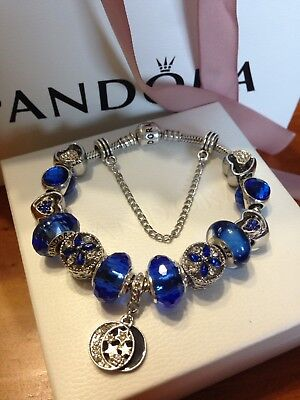 Authentic pandora silver bracelet with silver plated charms