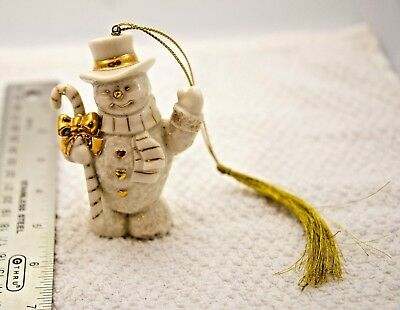 Collectible Lenox snowman ornament with tassel holding golden striped candy cane