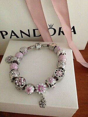 Authentic Pandora pink  leather bracelet with  silver plated charms
