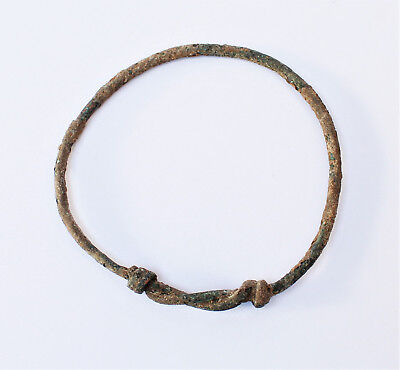 An ancient bronze bracelet with simple hammered ends. dating 2nd-4th century AD