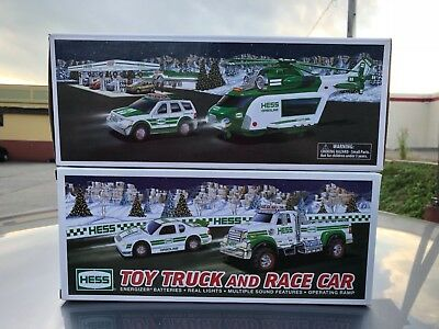 2011 Hess toy Truck & race car Brand New & 2012 Hess helicopter & rescue nib !