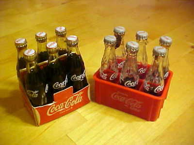 Two Miniature Six Pack Crates Of Glass Coca-Cola Bottles: One Mint, One Not
