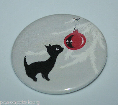 BLACK KITTEN SEES SELF IN CHRISTMAS ORNAMENT PIN BUTTON Vintage Holiday Cat Art