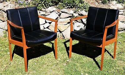 A Pair of Mid Century 1950's Retro arm chairs with Vinyl Upholstery by Fler