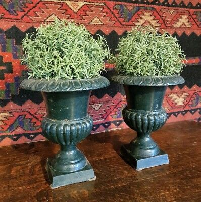 A matching pair of cast french garden urns