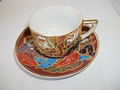 Antique Japanese Satsuma moriage style gilded porcelain tea cup and saucer