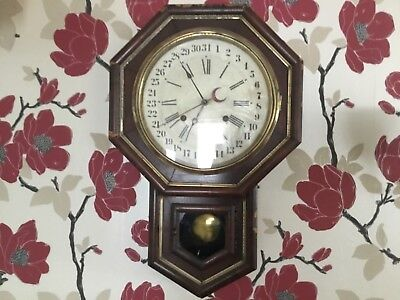 Antique drop dial wall clock . With date dail. Rare .