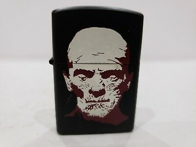 Vintage Working Black Enamel Cigarette Lighter . print of  MAN FACE