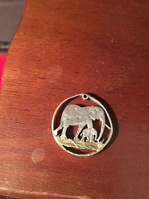 Hand Carved Elephant Coin Pendant